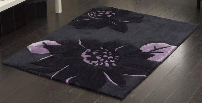 siyah çiçekli kabartmalı dekoratif halı modeli